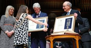 Lord Mayor of Belfast Nuala McAllister presents former US president Bill Clinton and former senator George Mitchell with the Freedom of the City of Belfast at a ceremony in Ulster Hall. Photograph: Kelvin Boyes/Pacemaker/PA Wire