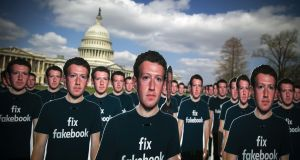 "Outside the Capitol in Washington, DC, protest group Avaaz set up 100 cutouts of Facebook chief Mark Zuckerberg with the words ""Fix Facebook"" on them. Photograph: Al Drago/Bloomberg"