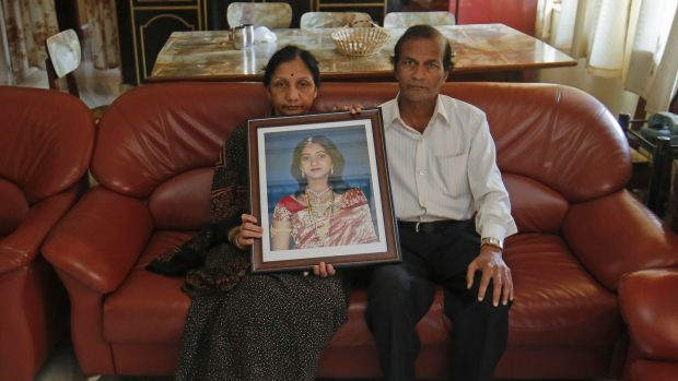 Mahadevi and Andaneppa Yalagi, parents of Savita Halappanavar, hold her portrait at their house in India in November 2012. Photograph: Danish Siddiqui/Reuters