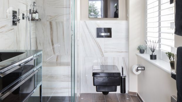 Masculine bathrooms seem to take their design cues from the Henry Ford – any colour as long as it's black. This manly space from West One bathrooms has a punchy black toilet and black tiling.