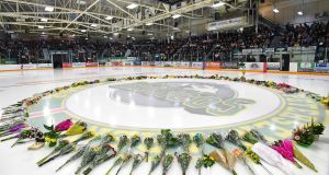 Flowers lie at centre of the ice as people gather for a vigil at the Elgar Petersen Arena, home of the Humboldt Broncos, to honour the victims of a fatal bus accident on  April 8th. Photograph: AFP Photo