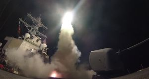 """It is unlikely the US and its allies will deploy war planes over Syria since Syrian and Russian air defences could shoot down aircraft. Low-flying cruise missiles are also not immune to interdiction."" Photograph: Ford Williams/US navy via Getty Images"
