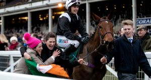 Katie Walsh onboard Relegate celebrates winning the Champion Bumper  at the Cheltenham Festival.  Photograph: James Crombie/Inpho