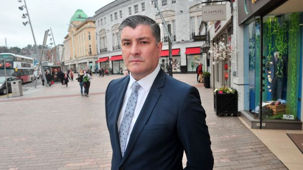 Retailer Eddie Mullins of Fitzgerald Menswear said it felt as if Cork City Council was causing 'death by a thousand cuts' with the introduction of the scheme. Photograph:Daragh Mc Sweeney/Provision