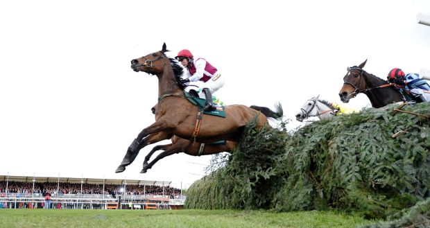 Seabass ridden by Katie Walsh leads at the final fence before losing to Neptune Collonges ridden by Daryl Jacob during the Grand National horse race at Aintree Racecourse in Liverpool, in April 2012. Photograph: Paul Ellis/AFP/Getty Images