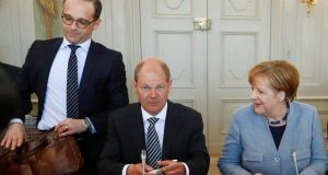 German foreign minister Heiko Maas (above left) will travel to Dublin on Thursday to meet Tánaiste Simon Coveney, while German  finance minister Olaf Scholz (above centre) and his Irish counterpart Paschal Donohoe will meet in Berlin. Photograph: Fabrizio Bensch/Reuters