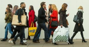 "Shoppers on Oxford Street, London: ""The UK economy has kept chugging along, even if weak sterling and higher inflation cut consumer spending last year and meant GDP growth, at 1.7 per cent, was the slowest among major economies."""