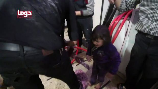 Unidentified volunteers spraying a girl with water at a makeshift hospital following an alleged chemical attack in Douma, Syria. Photograph: AFP Photo/Douma City Coordination Committee