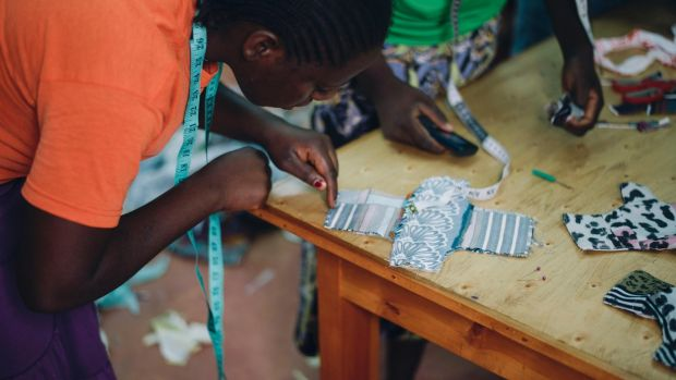 Making reusable sanitary pads from leftover material in the Stitching Academy, founded by Soko Kenya. Photograph: Fionn McCann