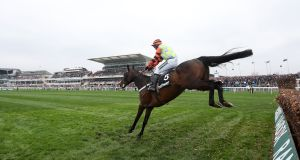 Might Bite ridden by Nico de Boinville jumps the last on the way  to winning the Betway Bowl Chase  at Aintree.  Photograph: David Davies/PA Wire