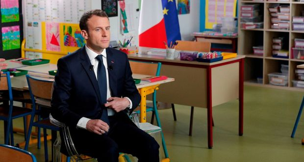 French President Emmanuel Macron Sits Inside A Classroom At A School In Berdhuis