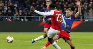 Arsenal's Danny Welbeck scores during the  Europa League quarter-final second leg against  CSKA Moscow at the  VEB Arena. Photograph:  Grigory Dukor/Reuters