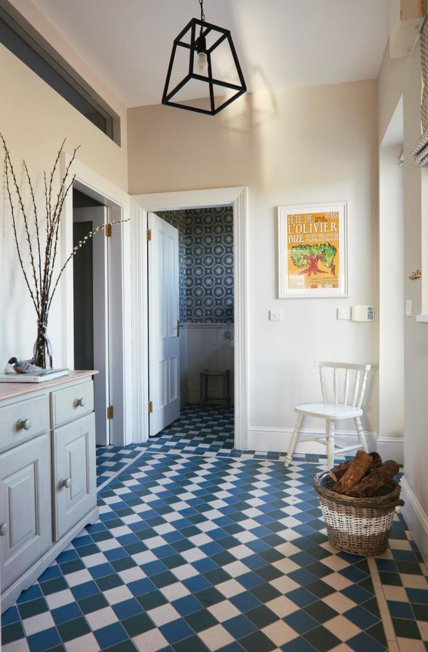 Hallway.tiling,side cabinet,wall mirror.pendant light Photograph by Philip LauterbachPhotographs by Philip Lauterbach