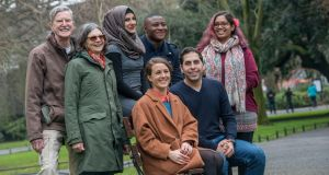New To The Parish author Sorcha Pollak, centre, with James and Ellen Baker; Maisa al-Hariri Azeez Yusuff;  Chandrika Narayanan Moham; and George Labbad, all of whom tell their story of moving to Ireland. Photograph: Brenda Fitzsimons