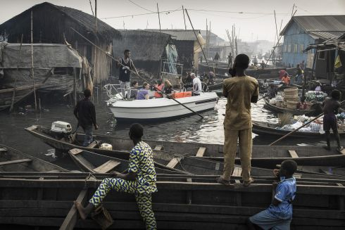 Jesco Denzel, Germany - Lagos Waterfronts under Threat - Contemporary Issues, first prize singles.  A boat with tourists from Lagos Marina is steered through the canals of the Makoko community, an ancient fishing village that has grown into an enormous informal settlement on the shores of Lagos Lagoon, Lagos, Nigeria.