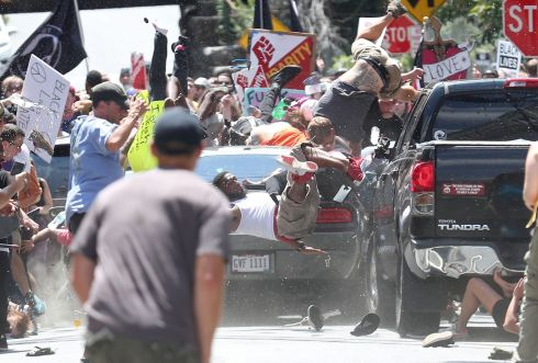 Ryan Kelly (USA) for The Daily Progress - Car Attack.  Spot News, second prize singles- People are thrown into the air as a car plows into a group of protesters demonstrating against the Unite the Right rally in Charlottesville, Virginia, on Aug. 12, 2017. The attack killed Heather Heyer and injured 19 others. James Alex Fields Jr., the alleged driver, was charged with second-degree murder.