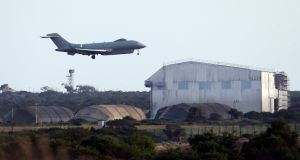 An aircraft landing at the British air   base at Akrotiri,  Cyprus. The same base  was used during the 1991 and 2003 US-led wars to mount attacks on Iraq. Photograph: AP Photo/Petros Karadjias