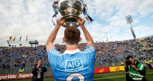 Dublin's Brian Fenton celebrates in front of Hill 16 last year. Even the suggestion of flogging the naming rights to historic Croke Park is sacrilege for many. Photograph: James Crombie/Inpho