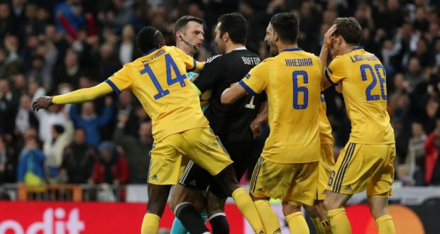 bc969fe213b Juventus goalkeeper Gianluigi Buffon confronts referee Michael Oliver  before being sent off during the dramatic quarter