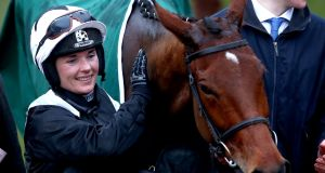 Katie Walsh celebrates with Relegate after winning at this year's Cheltenham Festival. Photograph:  James Crombie/Inpho