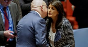 Nikki Haley, US ambassador to the UN greets her Russian counterpart Vasily Nebenzya. The US, Britain and France have blamed the chemical weapons attack on Syrian president Bashar al-Assad. Photograph: Reuters/Eduardo Munoz