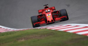 Ferrari's  Sebastian Vettel  on track during qualifying for the Formula One Grand Prix of China at Shanghai International Circuit. Photograph: Clive Mason/Getty Images