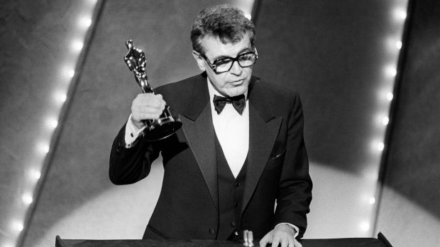 Milos Forman after winning the best director Oscar for holds up his Oscar for his film Amadeus in 1985. Photograph: AFP/Getty Images