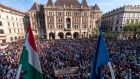 Anti-Orban demonstrators gather at the building of the Hungarian State Opera in Budapest on Saturday. Photograph: Zsolt Szigetvary/MTI via AP