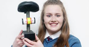 Breda Magner (16) shows the CycleSafe 2000 safety device for cyclists at the launch of the Student Enterprise National Final. She helped develop the device with classmates Evan Condon (16) and E'ueonn Ferron, of Desmond College, Newcastle West  Co Limerick. Photograph: Leon Farrell/Photocall Ireland