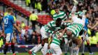 Tom Rogic is mobbed by his Celtic team-mates after scoring their first goal in the Scottish cup semi-final against Rangers at  Hampden Park. Photograph: Russell Cheyne/Reuters