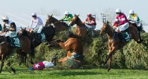 Alpha Des Obeaux ridden by Rachael Blackmore falls at the chair fence during the Grand National at Aintree racecourse. Photograph: Peter Powell/EPA