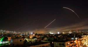 Syrian air strike: missiles streak across Damascus early on Saturday. Photograph: Hassan Ammar/AP