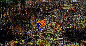 People march in Barcelona calling for the return of the 16 Catalan leaders who are in prison or have fled the country. Photograph: AFP