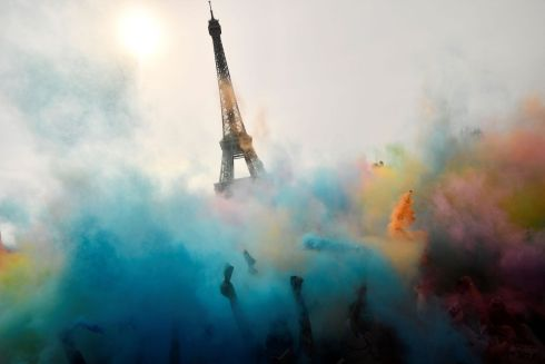 POWDER SHOWER: Participants celebrate at the end of the Color Run 2018 in front of the Eiffel Tower in Paris. The 5k event has no winners or prizes, and runners are showered with coloured powder at stations along the route. Photograph: Christophe Simon/AFP/Getty Images