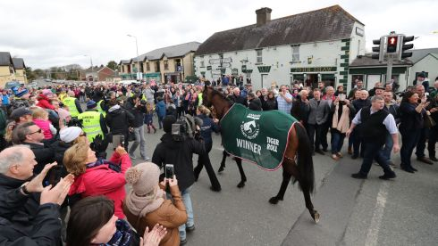 GET 'EM TIGER: Trainer Gordon Elliot with Grand National winner Tiger Roll during their homecoming parade through Summerhill Village, Co Meath. Photograph: Niall Carson/PA Wire