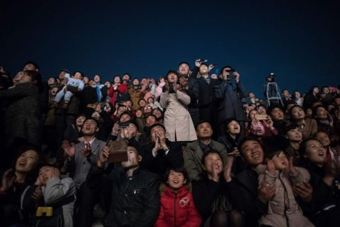 PYONGYANG CELEBRATIONS: Spectators enjoy a fireworks display over the Taedong river during celebrations marking the anniversary of the birth of former North Korean leader Kim Il-sung in Pyongyang. Photograph: Ed Jones/AFP/Getty Images