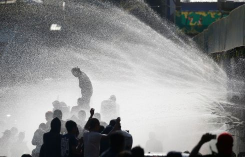 BIG SPLASH: Residents enjoy a hosing during the third day of the Thingyan water festival in Yangon, Myanmar.  Large groups of people congregate during the festival to celebrate by splashing water and throwing powder at each other, symbolising cleansing and washing away of sins of the previous year. Photograph: Lynn Bo Bo/EPA