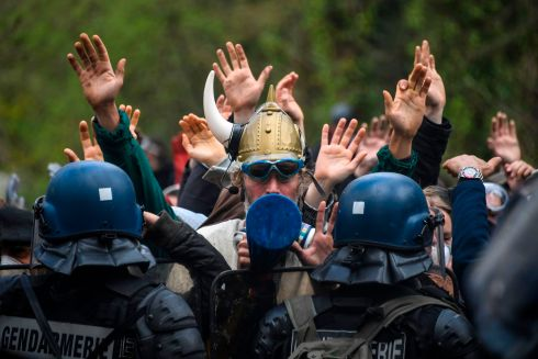 ANTI-AIRPORT PROTESTERS: Protesters face anti-riot officers of the Gendarmerie mobile security forces during an ongoing operation to clear the ZAD (Zone to defend) anti-airport camp in Notre-Dame-des-Landes, northwestern France. Photograph: Damien Meyer/AFP/Getty Images