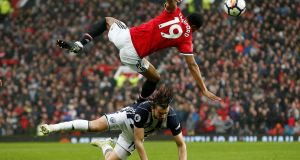 Manchester United's Marcus Rashford  and West Brom's Jay Rodriguez in action at Old Trafford. Photograph:   Reuters/Andrew Yates