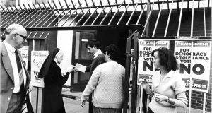 A nun hands out 'Yes' leaflets at the Basin Lane polling station in Dublin on referendum day 1983. Photograph: Pat Langan