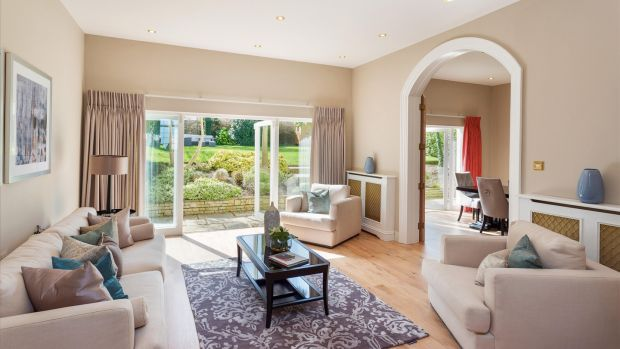 A large family room at the back of the house is one of three separate but linked rooms which all have French doors opening into the back garden