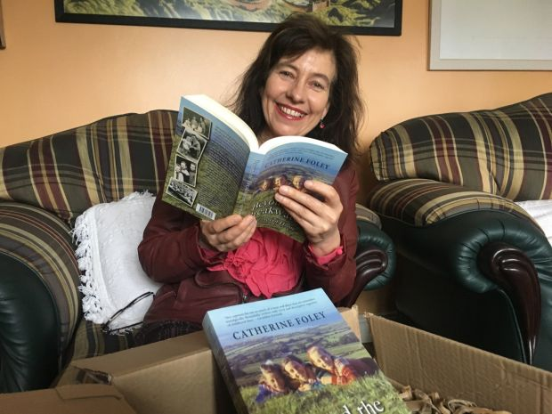 Catherine Foley with her new book