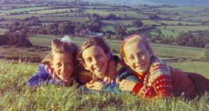 Catherine and her sisters: I'm in the middle in a green fair isle while Miriam to my left is wearing a red striped one and RoseAnn is in navy