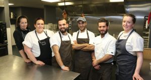 Chefs Louise Bannon, Jess Murphy, Mhd Ahyam Orabi, Amer Marai, Ahmad Orabi and Christine Walsh working on the Far Fetched refugee fundraising dinner in Galway last October.