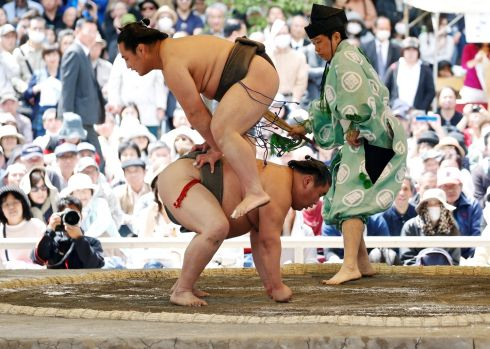 BUM FIGHT: Sumo wrestlers perform a show fight during an annual sumo tournament dedicated to the Yasukuni Shrine in Tokyo, Japan. Photograph: Toru Hanai/Reuters