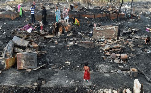 ROHINGYA CRISIS: Rohingya refugees look for their belongings in New Delhi, following a fire that broke out at their camp that left about 200 people homeless. Photograph: Money Sharma/AFP/Getty Images