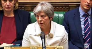 Prime minister Theresa May listens to Labour leader Jeremy Corbyn speaking after she made a statement to MPs in the House of Commons over her decision to launch air strikes against Syria. Photograph: PA Wire