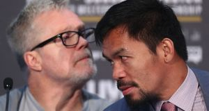 Trainer Freddie Roach and boxer Manny Pacquiao:  The 39-year-old congressman has not his final decision who will be his trainer for the fight in Kuala Lumpur on July 14th. Photograph:  Chris Hyde/Getty Images