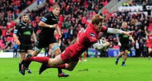 Rhys Patchell of Scarlets scores a try against Glasgow Warriors in their Guinness Pro14 clash at Parc y Scarlets on April 7th. Photograph: Alex Davidson