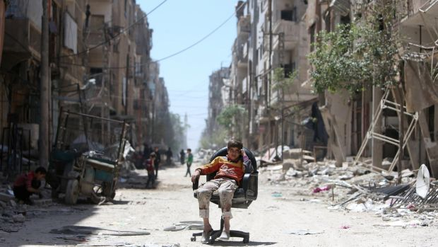 A bomb-damaged Douma street in the wake of air strikes. Photograph: Ali Hashisho/Reuters